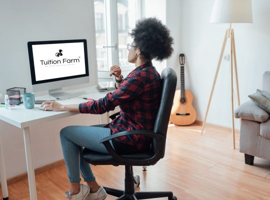 Tuition Farm - Woman at desk